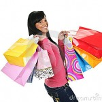 happy-young-black-woman-shopping-bags-17215370