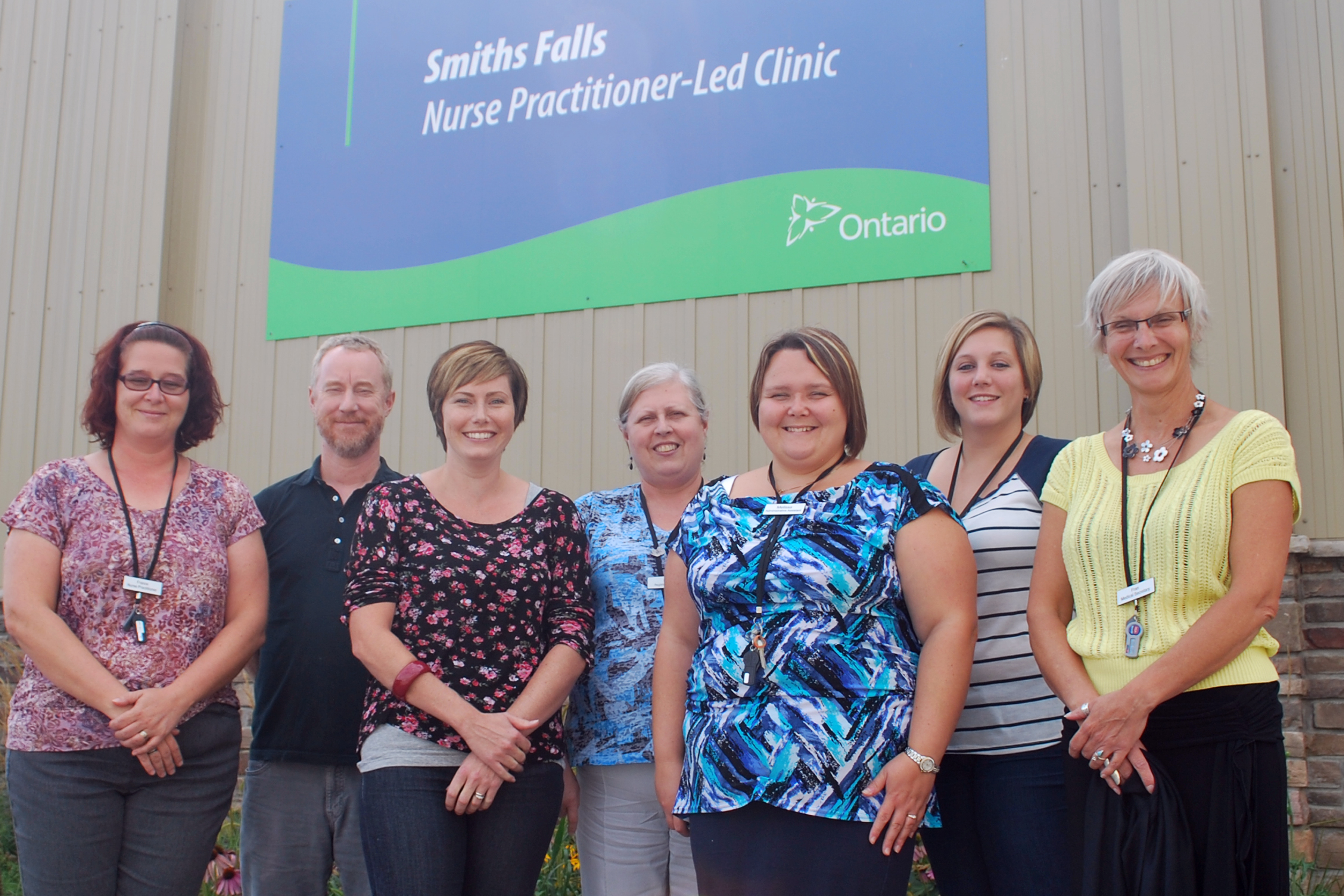 Staff from the Smiths Falls Nurse Practitioner-Led Clinic stepped out for a quick photo in front of their 52 Abbott St. location.  The clinic is currently taking on new patients in need of primary health care.  From left to right: Nurse Practitioner, France Murdoch; Interhealth Professional, Simon Wright; Administrative Lead, Leeann Brennan; Registered Nurse, Pat Saunders; Administration Assistant, Melissa LaSalle; and Reception and Medical Secretaries, Sarah Mann and Fran Buttner.